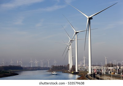 Wind turbines near canal Hartel in industrial area Europoort of Rotterdam in the Netherlands