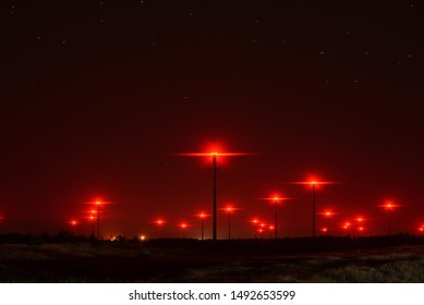 Wind turbines at night. Long exposure. Field, Stars.
