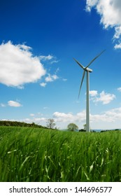 Wind turbines on a beautiful field of barley.
