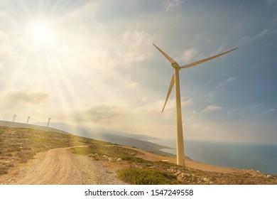 Wind turbines on beautiful sunny mountain landsape. Green power generation concept.