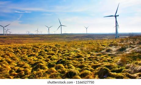 Wind turbines on a bleak moor.