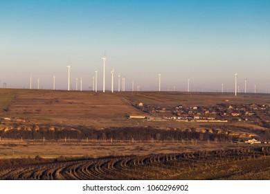 Wind turbines on the Cernavoda hills in Constanta Romania at dusk
