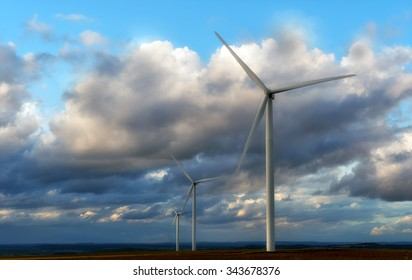 wind turbines on cloudy background