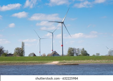 Wind Turbines on the Elbe with Farm house in Germany, Lower Saxony