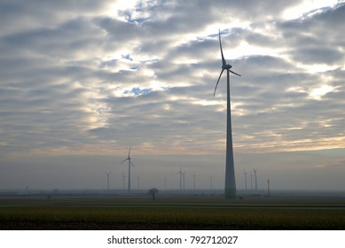 Wind turbines on field and expressive sky, Austria