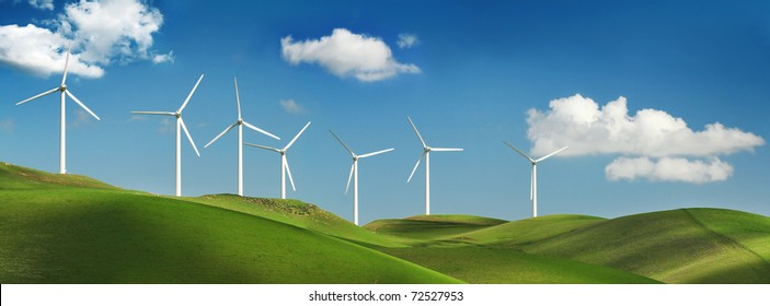 Wind turbines on green spring hills of California. Altamont Pass wind farm near Livermore.