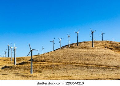 Wind turbines on the hills at Altamont Pass, in California, with morning light