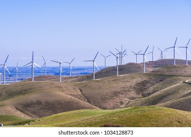 Wind turbines on the hills of east San Francisco bay, Stockton valley in the background, Alameda county, California