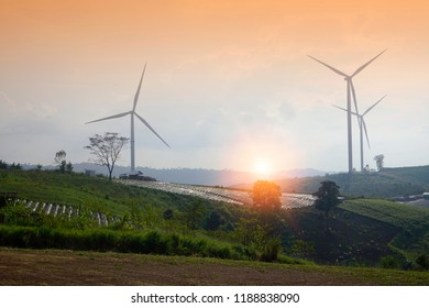 wind turbines on the mountain. wind turbine field and Rotary propeller moving at sunset