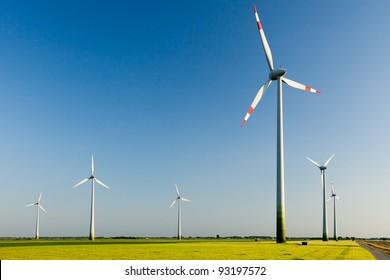 Wind turbines on sunny day.