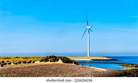 Wind Turbines at the Oosterschelde inlet at the Neeltje Jans island at the Delta Works Storm Surge Barrier in Zeeand Province in the Netherlands
