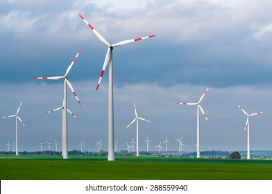 Wind turbines in the open countryside on windy day with dark clouds in the sky; Alternative power generation