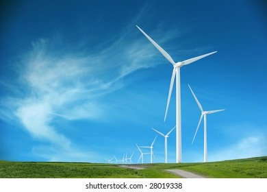 Wind turbines in an open field on cloudy day