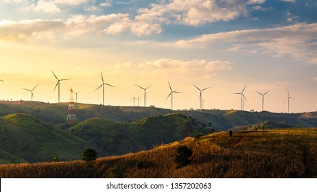 Wind turbines and Orange sunset sky. Beautiful mountain landscape with wind generators turbines,Thailand. Renewable energy concept.