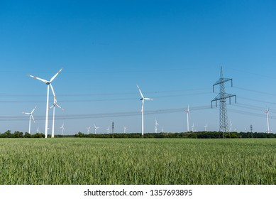 Wind turbines and an overhead power line in Germany