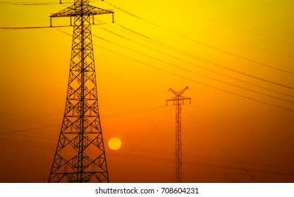 Wind turbines with power line in the sunset