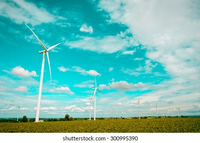 Wind turbines produce electricity Alternative energy with sky and cloud background pastels filters
