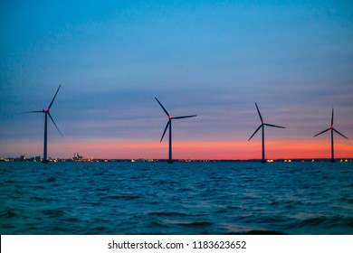 Wind turbines producing energy along the coastline. Marine landscape