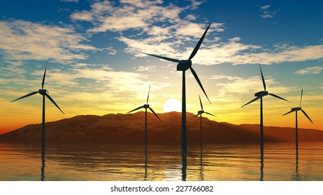 Wind turbines in the sea on a background of mountains and sunset