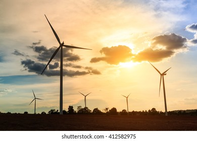 Wind turbines silhouette at sunset in Thailand
