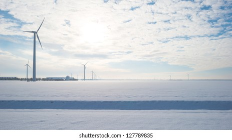 Wind turbines in a snowy field