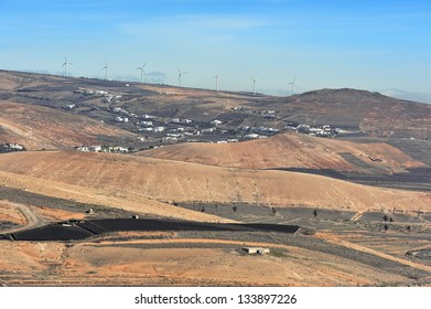 wind turbines staying on hill at  Lanzarote Island, Canary Islands, Spain