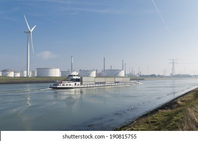 wind turbines and storage silos for petrol in the rotterdam harbor area