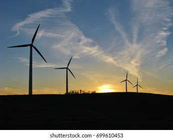 Wind turbines at sunset.