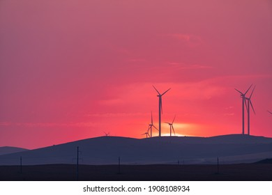 Wind turbines at sunset in Dobrogea County, Romania.