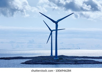 Wind turbines at sunset. Renewable energy. Finland seascape. Horizontal