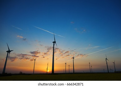 Wind turbines with sunset sky
