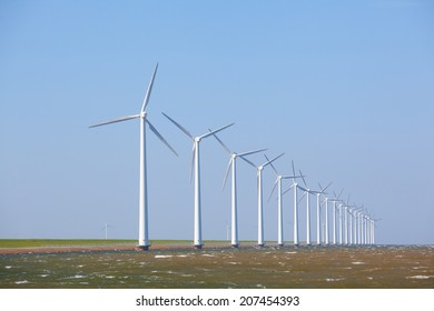 Wind turbines in the water with a clear blue sky