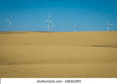 Wind turbines and wheat fields in eastern Washington state