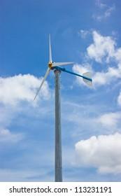 Wind wheel with brightly blue sky.