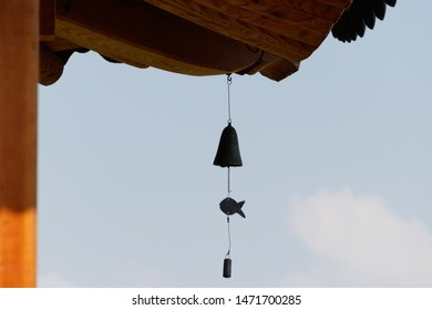 Wind-bell with metal fish at the eaves of Korean traditional House. wind-shaking  wind chime.