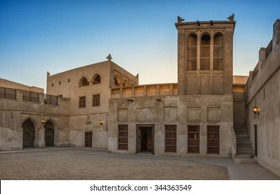 The wind-catcher tower at sunset over a courtyard of the restored traditional Arabian house of pearl trader Shaikh Isa bin Ali, Muharraq, Bahrain.