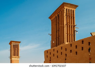Windcatcher towers is a traditional Persian architectural element to create natural ventilation in buildings, old city Yazd Iran.