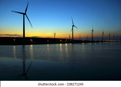 wind-driven generator with sunset in Taiwan
