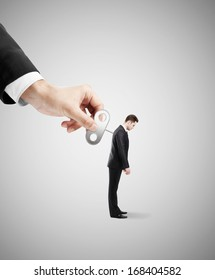 winder in hand of a businessman gets