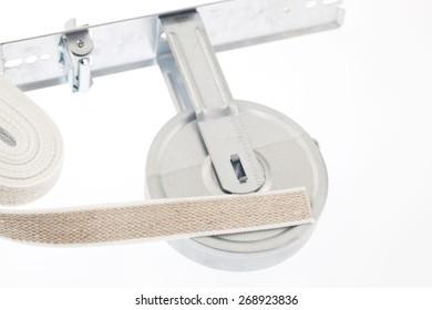 Winder and strap for roller shutter