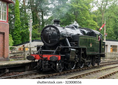 WINDERMERE, LAKE DISTRICT/ENGLAND - AUGUST 21 : 42073 BR Fairburn, at Lakeside Station Windermere in the Lake District England on August 21, 2015. Unidentified man.