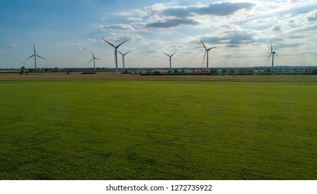 Windfarm with Bluesky in Horizon and Forefront Greenery