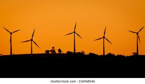 A wind-farm at sunset in rural Australia