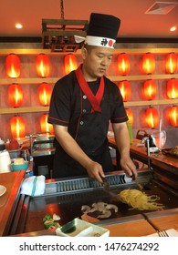 Windham, Maine / USA - July 25 2019: Hibachi chef preparing food at Eagle Sushi and Steakhouse grand opening