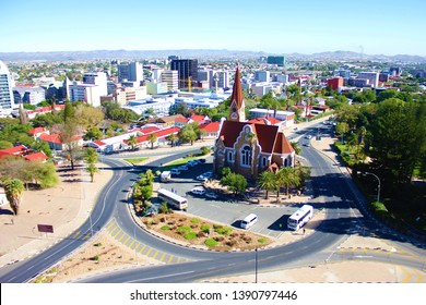 Windhoek,Namibia.April 2019.The Christ Church or Christuskirche is a historic Lutheran church.It was designed by architect Gottlieb Redecker,dedicated in 1910 .Arial city view of Windhoek.