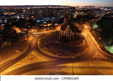 Windhoek,Namibia.April 2019.The Christ Church or Christuskirche is a historic Lutheran church.It was designed by architect Gottlieb Redecker,dedicated in 1910 .Arial city view of Windhoek at night.