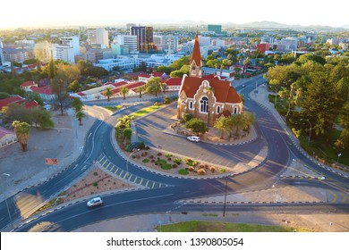 Windhoek,Namibia.April 2019.The Christ Church or Christuskirche is a historic Lutheran church.It was designed by architect Gottlieb Redecker,dedicated in 1910 .Arial city view of Windhoek at sunset.