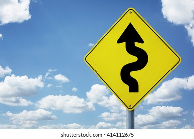 Winding arrow road sign concept for business difficulties, problems and confusion