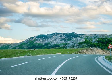 A winding asphalt road is located near Zabljak in the north of Montenegro.
