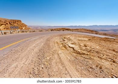 Winding Asphalt Road in the Negev Desert in Israel